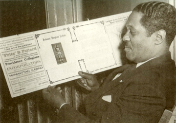 Fritz Pollard looks at a basketball ad