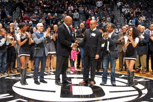 Nets General Manager Billy King presents Claude Johnson with award