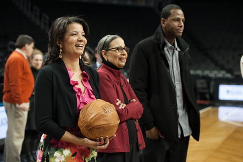 Some descendants of Brooklyn's Smart Set Athletic Club basketball team–Julia Alexander, Gail Lumet Buckley, and Mark Moore–stand on the court at the Barclays Center (Feb. 4, 2013). (Photo by Nancy Borowick)
