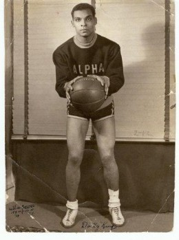 "William ""Dolly"" King at Long Island University, wearing a sweatshirt representing his college fraternity, Alpha Phi Alpha.Courtesy of the Michael C. King Collection"