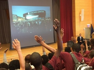 Claude Johnson visits a school in the Brownsville section of Brooklyn in collaboration with the community relations and educational programs of the Brooklyn Nets
