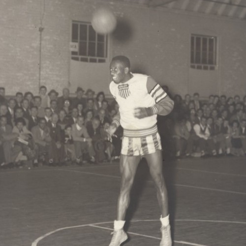 "Harlem Globetrotters player Reece ""Goose"" Tatum attempts a field goal from just inside the free throw line using his head, 1949."